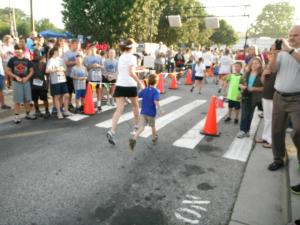 Ollie and I crossing the finish line at his first fun run in Spring 2012