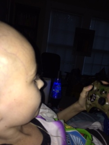 This is the last picture I took of Ollie - playing his beloved Minecraft with his favorite xbox controller.